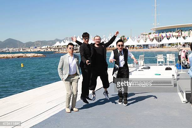 Actor Xia Yu actor Chen Kun director Wu Ershan and actor Huang Bo pose near Cannes beach during their promoting 'The Ghouls' on the 68th annual...