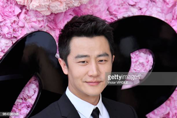 Actor Xuan Huang during the Dior Homme Menswear Spring/Summer 2019 fashion show as part of Paris Fashion Week on June 23 2018 in Paris France