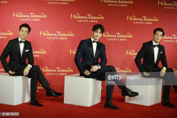 Actor Yang Yang poses with his wax figures at Madame Tussauds Beijing on July 19 2017 in Beijing China