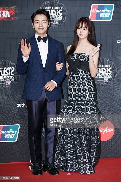 Actor Yeo Jingoo and actress Kim Sohyun arrive at the red carpet of the 2015 Mnet Asian Music Awards at AsiaWorldExpo on December 2 2015 in Hong Kong...