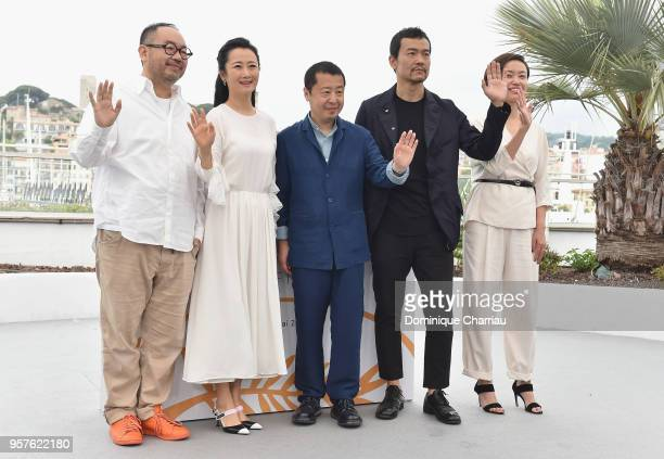 Actor Yibai Zhang actress Tao Zha director Zhangke Jia actor Fan Liao and a guest wave as they attend the photocall for 'Ash Is The Purest White '...
