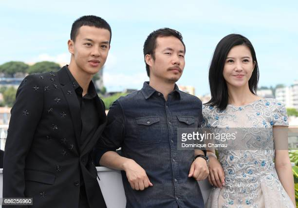 Actor Yin Fang director Li Ruijun and actor Yang Zishan attend the 'Walking Past The Future ' photocall during the 70th annual Cannes Film Festival...