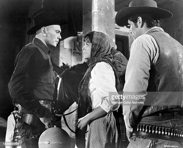 Actor Yul Brynner and actress Elisa Montes on set of the movie Return of the Seven in 1966