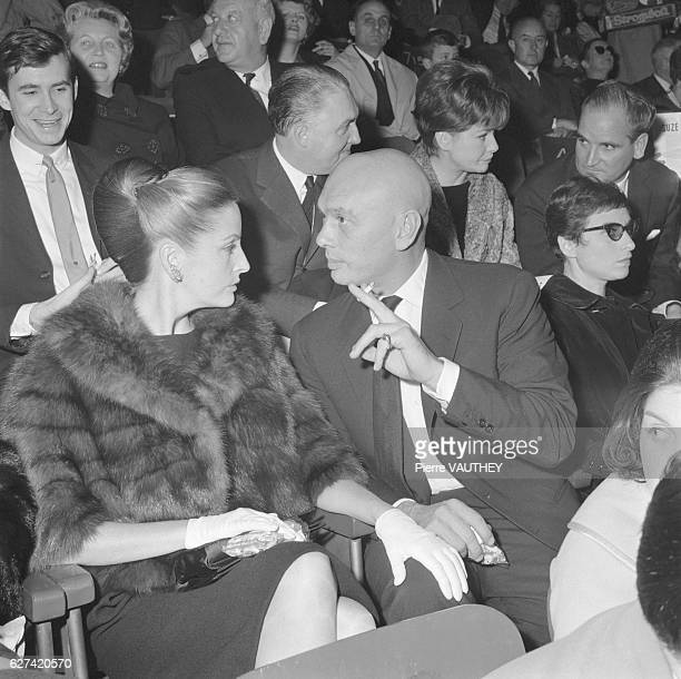Actor Yul Brynner and his wife Doris Kleiner chat together while at the theater Seated behind Kleiner is actor Anthony Perkins