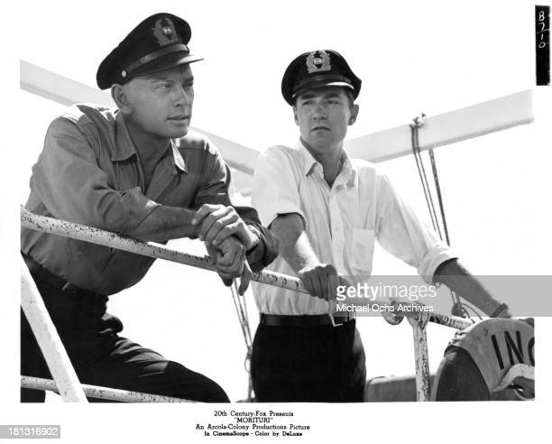 Actor Yul Brynner as Captain Mueller and Martin Kosleck as Wilke on the set of the 20th Century Fox movie Morituri in 1965