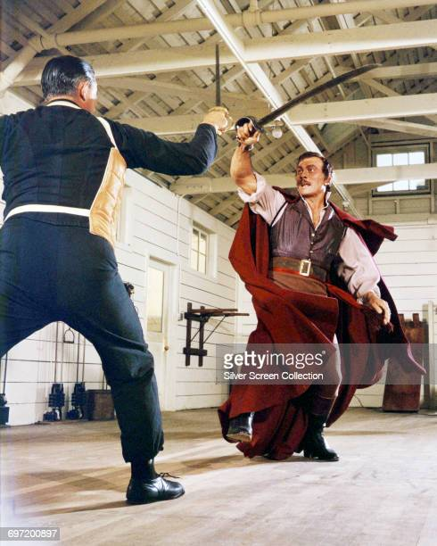 Actor Yul Brynner as pirate Jean Lafitte training with his fencing coach on the set of the Paramount Pictures film 'The Buccaneer' 1958
