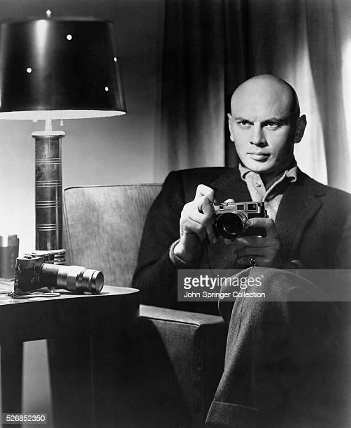 Actor Yul Brynner Holding a Camera
