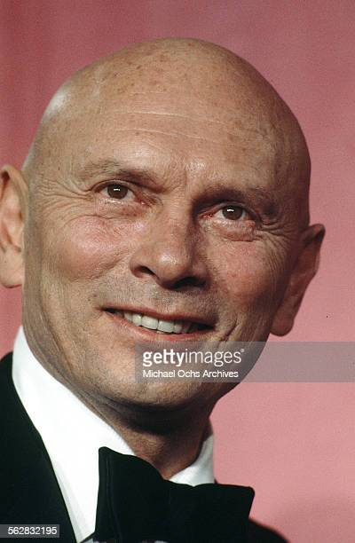 Actor Yul Brynner poses backstage after presenting Best Foreign Language Film award during the 46th Academy Awards at Dorothy Chandler Pavilion in...