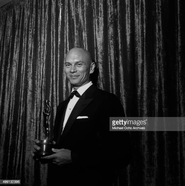 Actor Yul Brynner poses with his Oscar award for The King and I at the Academy Awards in Los Angeles California