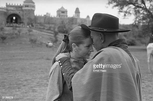 Actor Yul Brynner spends an affectionate moment with his wife Doris Kleiner on the set of the film 'Taras Bulba' directed by J Lee Thompson