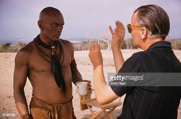 Actor Yul Brynner with director J Lee Thompson on the set of the film 'Kings of the Sun' in Mexico 1963