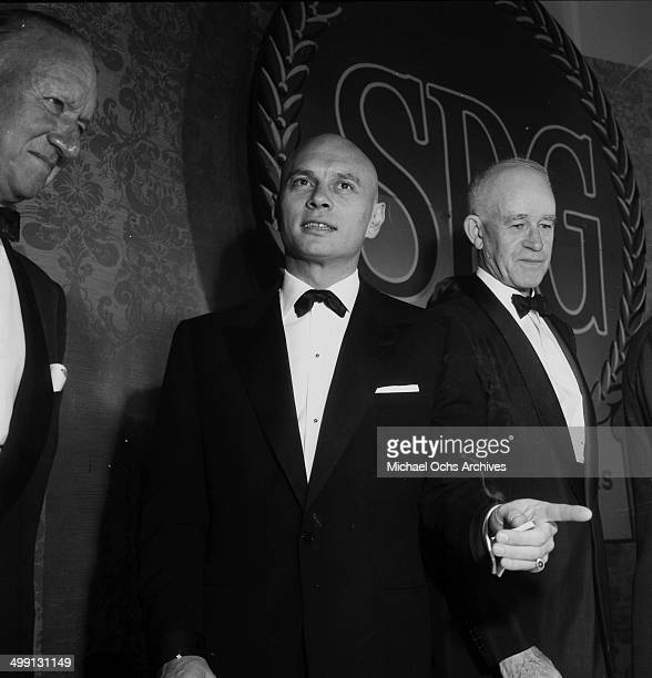 Actor Yul Brynner with General Omar Bradley attend the Screen Producers Awards in Los Angeles, California.