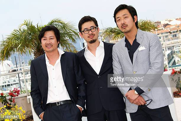 Actor Yunseok Kim Director Hongjin Na and actor Jungwoo Ha attends The Yellow Sea Photocall during the 64th Cannes Film Festival at the Palais des...
