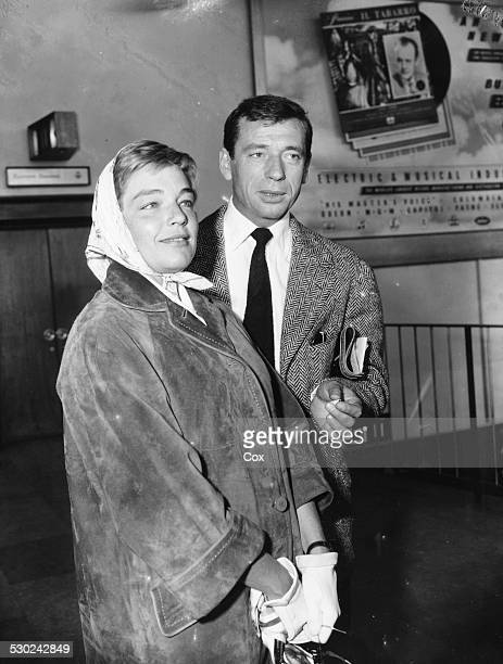 Actor Yves Montand and his wife Simone Signoret arriving at London Airport in the country to attend the premiere of 'The Witches of Salem' England...