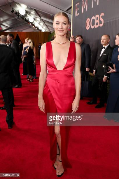 Actor Yvonne Strahovski walks the red carpet during the 69th Annual Primetime Emmy Awards at Microsoft Theater on September 17 2017 in Los Angeles...