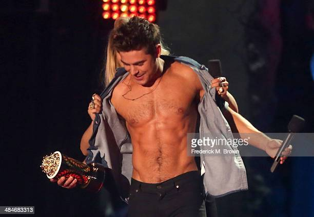 Actor Zac Efron accepts the Best Shirtless Performance award for 'That Awkward Moment' onstage at the 2014 MTV Movie Awards at Nokia Theatre LA Live...