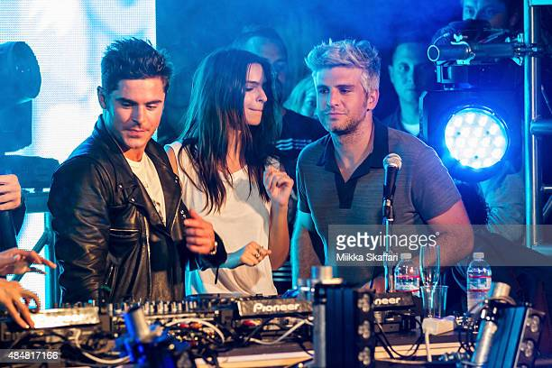Actor Zac Efron actress Emily Ratajkowski and director Max Joseph get on stage at We Are Your Friends tour afterparty on August 21 2015 in San...