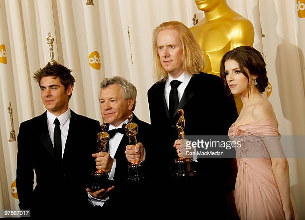 Actor Zac Efron and actress Anna Kendrick pose with Ray Beckett winner Best Sound Mixing for The Hurt Locker and Paul NJ Ottosson winner Best Sound...