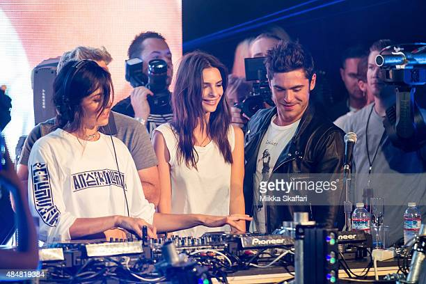 Actor Zac Efron and actress Emily Ratajkowski join on stage with DJ Anna Lunoe at We Are Your Friends tour afterparty on August 21 2015 in San...