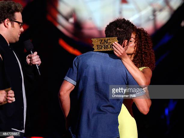 Actor Zac Efron and Tiffany Luce onstage at the 2014 MTV Movie Awards at Nokia Theatre LA Live on April 13 2014 in Los Angeles California