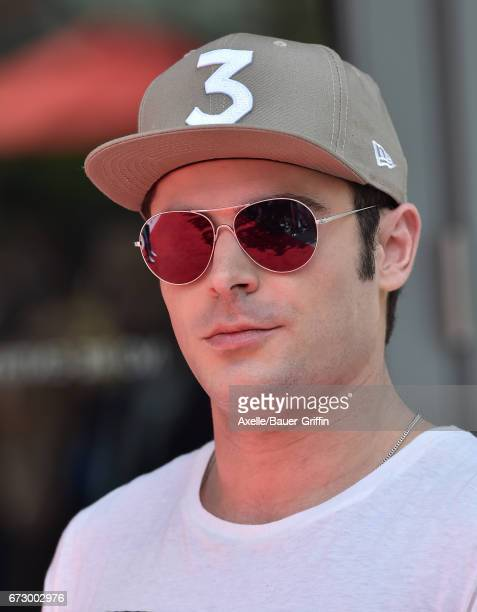 Actor Zac Efron arrives at the 'Baywatch' SlowMo Marathon at Microsoft Square on April 22 2017 in Los Angeles California