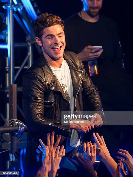 Actor Zac Efron gets on stage at We Are Your Friends tour afterparty on August 21 2015 in San Francisco California