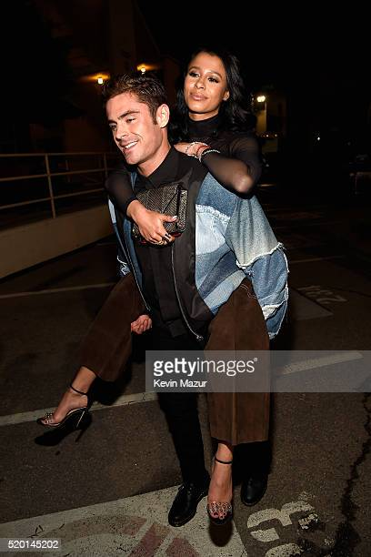 Actor Zac Efron gives a piggyback ride to Model Sami Miro during the 2016 MTV Movie Awards at Warner Bros Studios on April 9 2016 in Burbank...