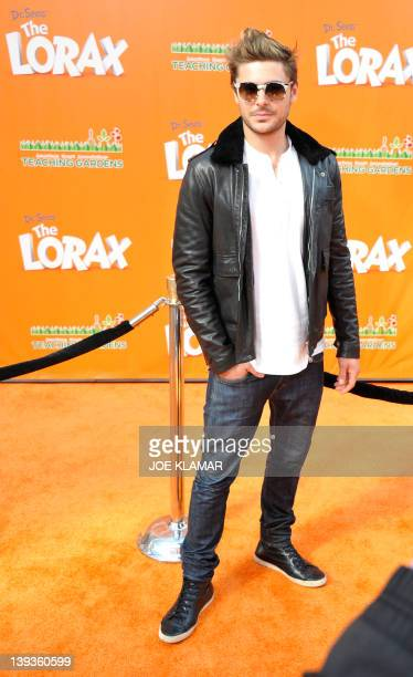 Actor Zac Efron poses for pictures as he arrives for the premiere of Dr Seuss' The Lorax at Universal Studios Hollywood on February 19 2012 in...