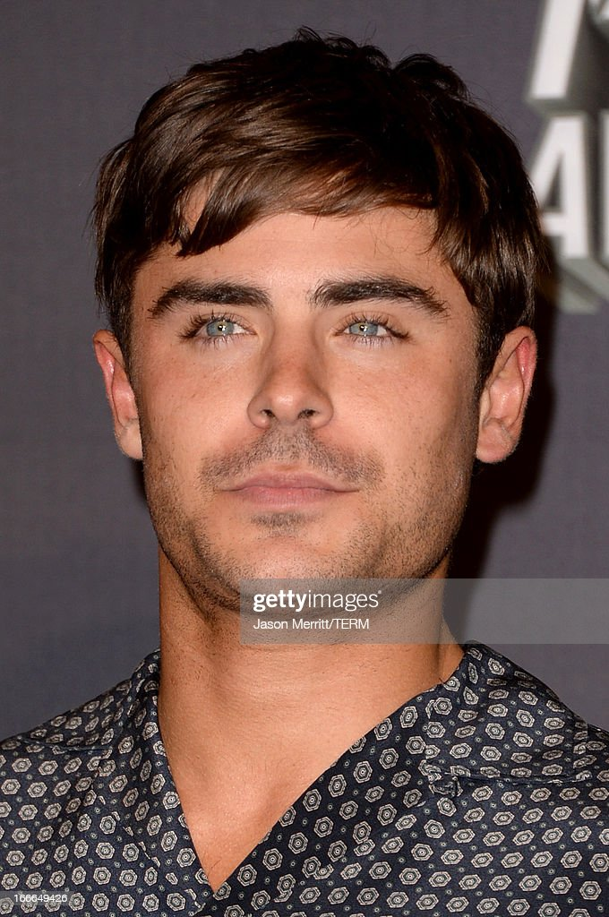 Actor Zac Efron poses in the press room during the 2013 MTV Movie Awards at Sony Pictures Studios on April 14, 2013 in Culver City, California.