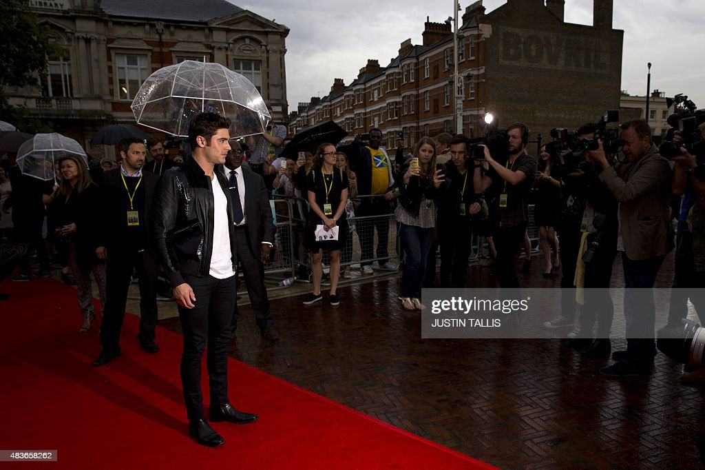 US actor Zac Efron poses on arrival for the premiere of We Are Your Friends in London on August 11, 2015. TALLIS