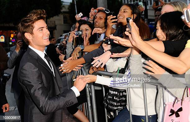 Actor Zac Efron signs autographs for fans as he arrives at the premiere of Universal Pictures' Charlie St Cloud held at the Regency Village Theatre...