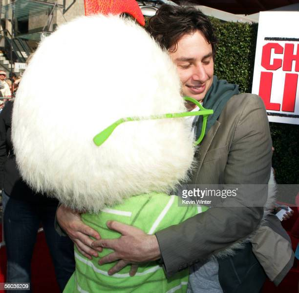 """Actor Zach Braff greets Chicken Little at the premiere of Disney's """"Chicken Little"""" at the El Capitan Theater on October 30, 2005 in Los Angeles,..."""