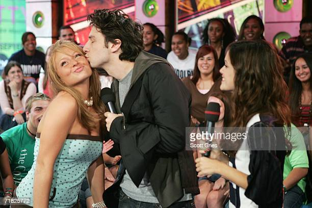 Actor Zach Braff kisses an audience member as actress Rachel Bilson watches during MTV's Total Request Live at the MTV Times Square Studios on...