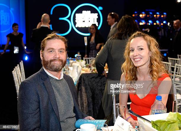 Actor Zach Galifianakis and Quinn Lundberg attend the 2015 Film Independent Spirit Awards at Santa Monica Beach on February 21 2015 in Santa Monica...