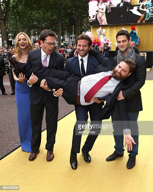 Actor Zach Galifianakis is carried by actress Heather Graham director Todd Phillips and actors Bradley Cooper and Justin Bartha as they attend 'The...