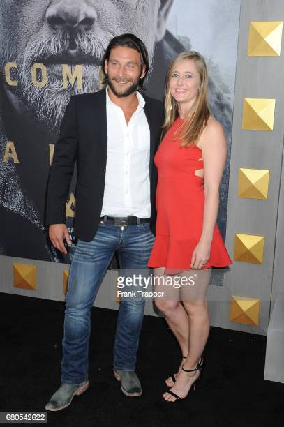 "Actor Zach McGowan and Emily Johnson arrive at the premiere of Warner Bros. Pictures' ""King Arthur: Legend Of The Sword"" at TCL Chinese Theatre on..."
