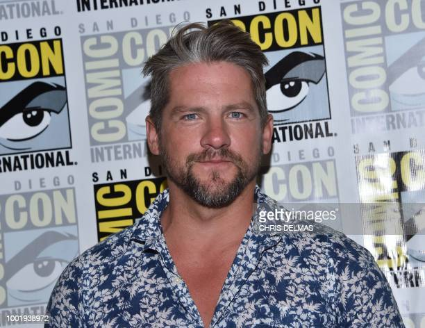 Actor Zachary Knighton arrives on the photo line for the CBS show Magnum PI at Comic Con in San Diego July 19 2018