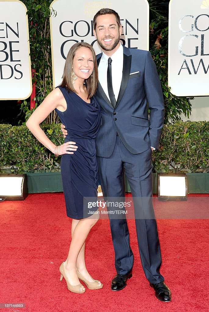 Actor Zachary Levi (R) and guest arrive at the 69th Annual Golden Globe Awards held at the Beverly Hilton Hotel on January 15, 2012 in Beverly Hills, California.