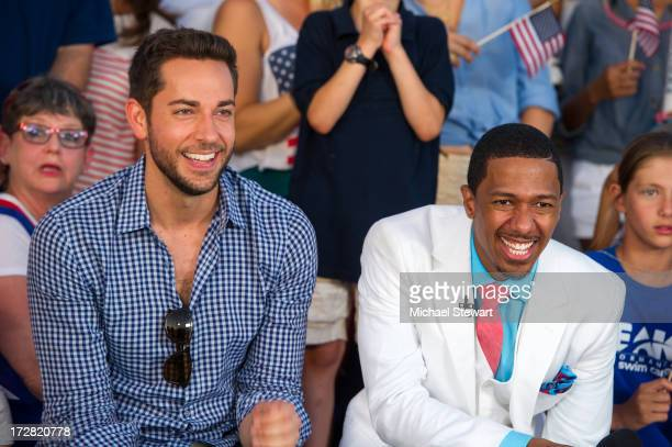 Actor Zachary Levi and TV personality Nick Cannon attend the 37th annual Macy's 4th of July Fireworks over the Hudson River on July 4 2013 in New...