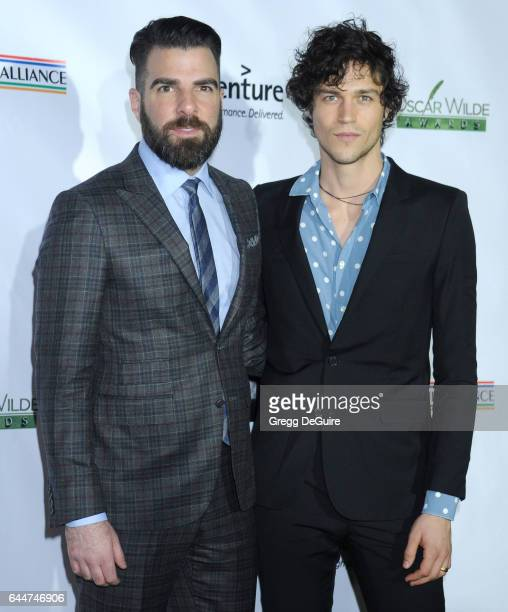 Actor Zachary Quinto and model Miles McMillan arrive at the 12th Annual Oscar Wilde Awards at Bad Robot on February 23 2017 in Santa Monica California