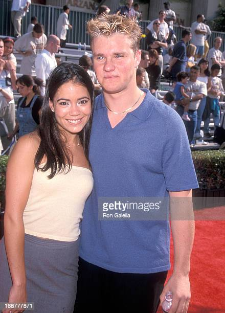 Actor Zachery Ty Bryan and date attend the 'Tarzan' Hollywood Premiere on June 12 1999 at the El Capitan Theatre in Hollywood California