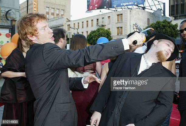 """Actor Zack Ward and musician Ben Moody joke around as they arrive at the World Premiere of """"LA Twister"""" on June 30, 2004 at the Grauman's Chinese..."""