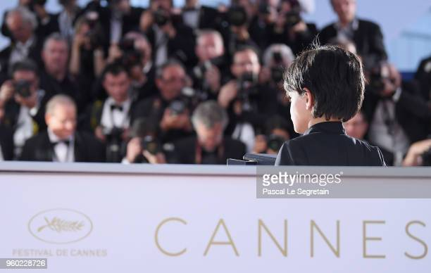 Actor Zain Alrafeea poses with Director Nadine Labaki's Jury Prize award for 'Capharnaum' at the photocall the Palme D'Or Winner during the 71st...