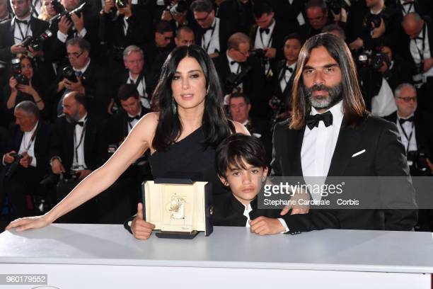 Actor Zain Alrafeea stands between Director Nadine Labaki posing with the Jury Prize award for 'Capharnaum' next to her producer and husband Khaled...