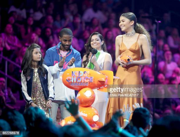 Actor Zendaya accepts the award for Favorite Female TV Actor from rapper Big Sean and internet personality Bethany Mota at Nickelodeon's 2017 Kids'...