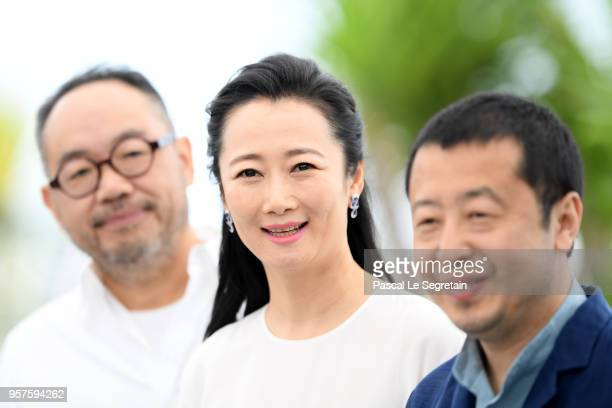 Actor Zhang Yibai actress Tao Zhao and director Zhangke Jia attend the photocall for 'Ash Is The Purest White ' during the 71st annual Cannes Film...