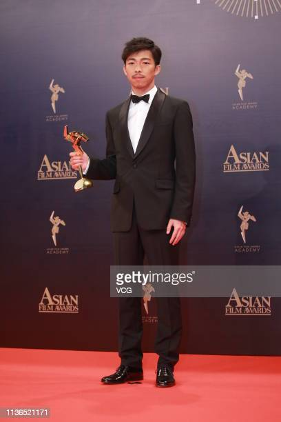 Actor Zhang Yu poses with the trophy backstage after winning the Best Supporting Actor during the 13th Asian Film Awards on March 17 2019 in Hong...