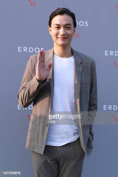 Actor Zhou Yiwei poses on the red carpet of Erdos Initiate/Infinite A/W 2019 Fashion Show on August 28 2018 in Beijing China