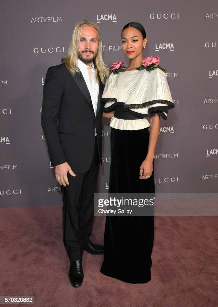 Actor Zoe Saldana wearing Gucci and artist Marco Perego attend the 2017 LACMA Art Film Gala Honoring Mark Bradford and George Lucas presented by...