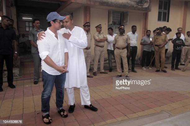 ActorAamir Khan and Business Tycoon Anil Ambani interacts during the funeral of late Krishna Raj Kapoor who passed away of cardiac arrest in Mumbai...